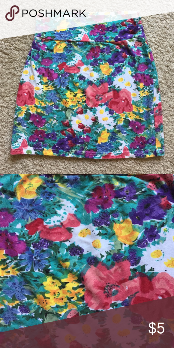 Tightfitting, floral miniskirt Tightfitting, floral miniskirt. Make an offer! Nasty Gal Skirts Mini