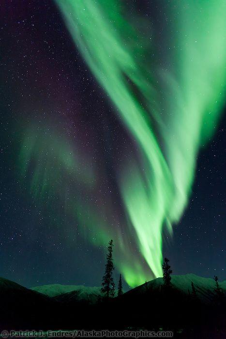 Arcs of aurora borealis over Brooks range | AlaskaPhotoGraphics.com