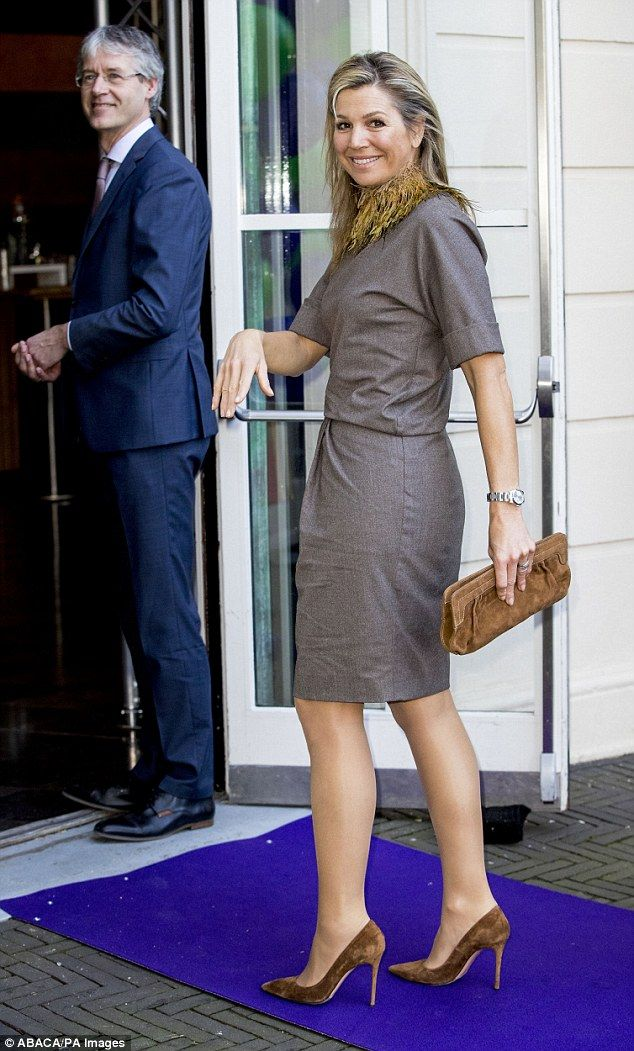 The Dutch royal, 46, worked business chic in a grey ensemble, injecting a stylish splash of colour with matching brown accessories
