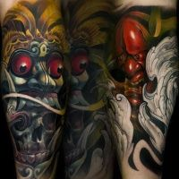 Neo japanese style colored arm tattoo of demonic masks with skull