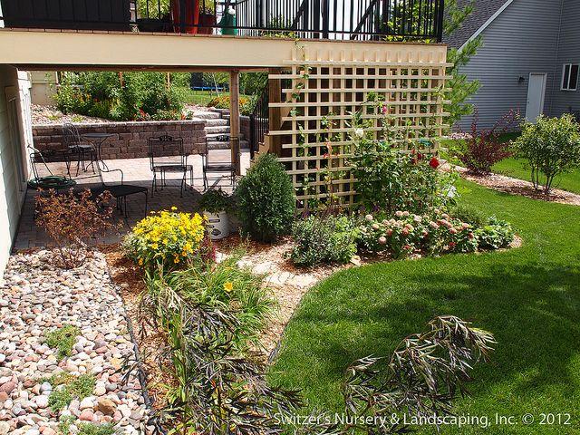 Garden Ideas For Minnesota paver patio under deck with retaining wall & steps - minnesota