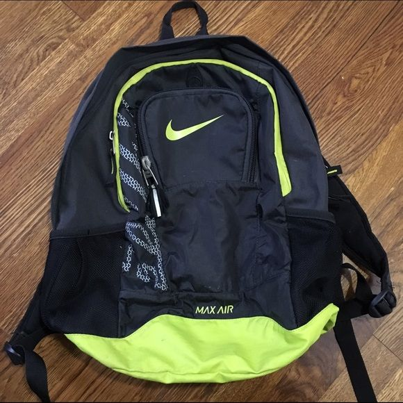 Nike backpack Black neon green backpack. Good condition. The only flaw is  the zipper thread is falling apart. Other than that d371a35df6460