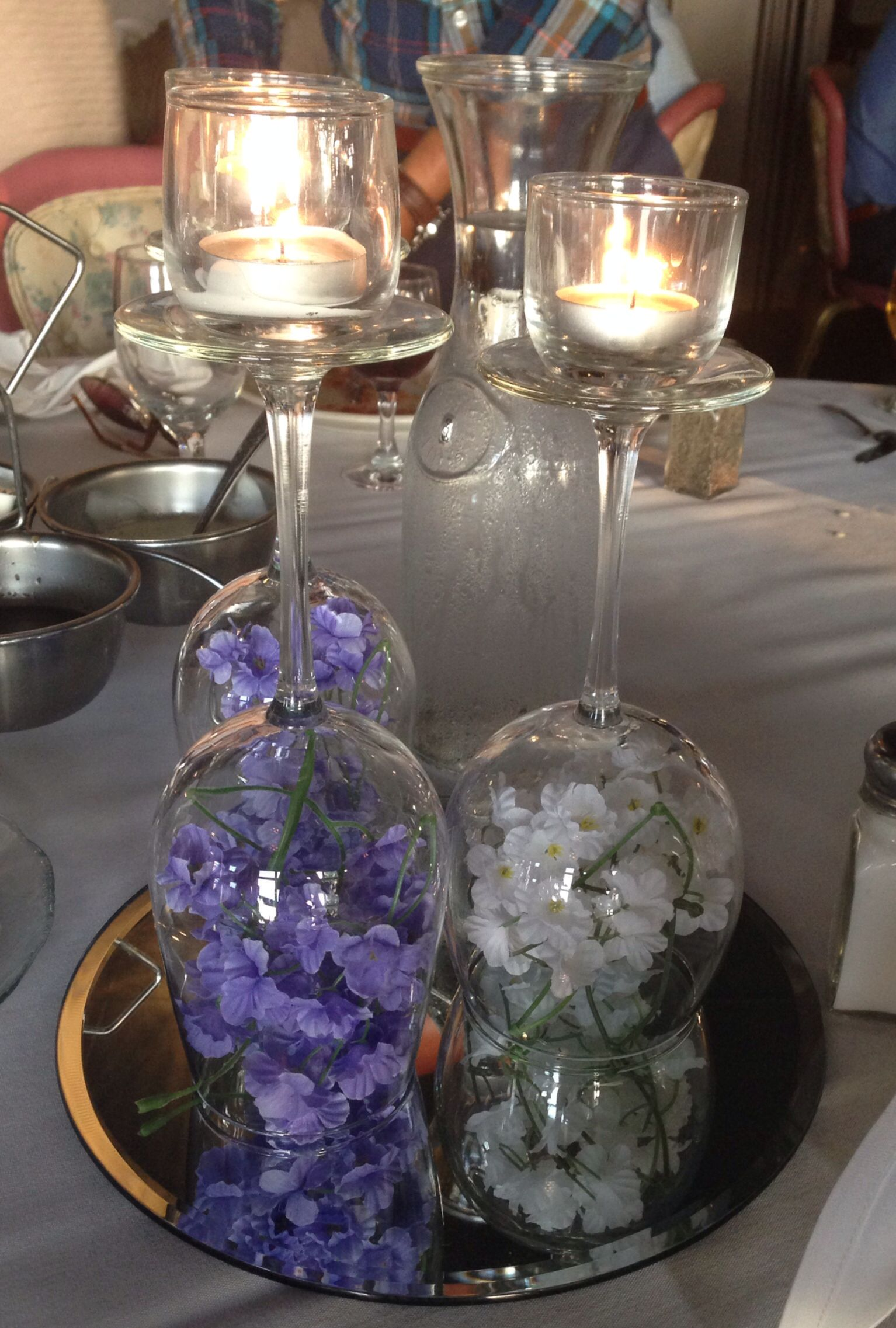 Wine Glass Centerpiece With Flowers And Candles Wine Glass Centerpieces Glass Centerpieces Wine Glass Candle Holder