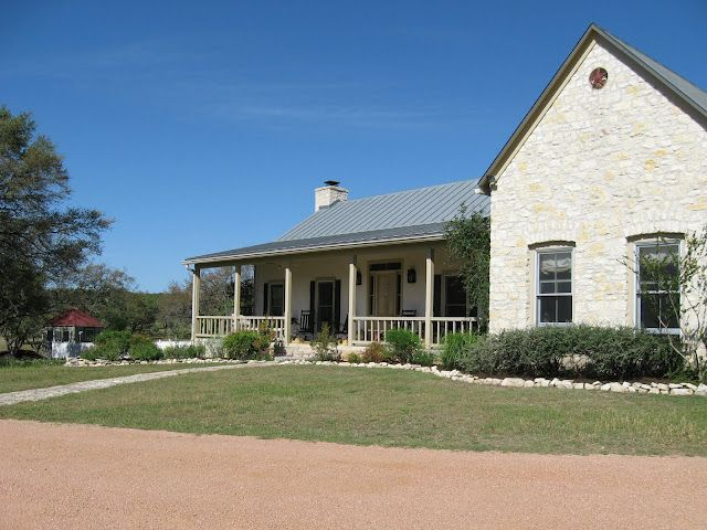Texas Hill Country German Farmhouse Standing Seam Metal Roof And Limestone Exterior Limestone House Hill Country Homes Old Stone Houses