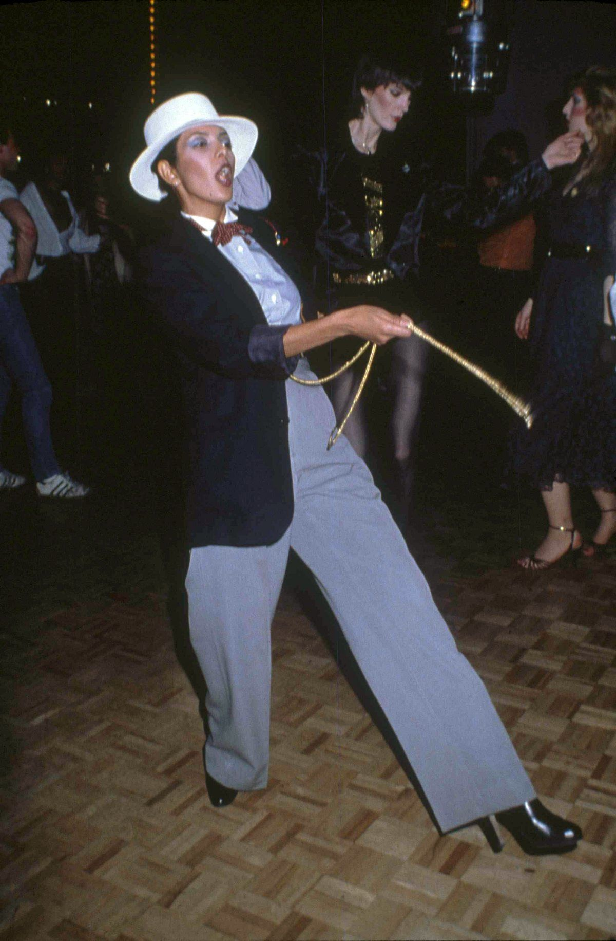 Women wearing zoot suits — menswear with high-waisted, wide-legged, tight-cuffed, pegged trousers — could be seen hitting the dance floor.