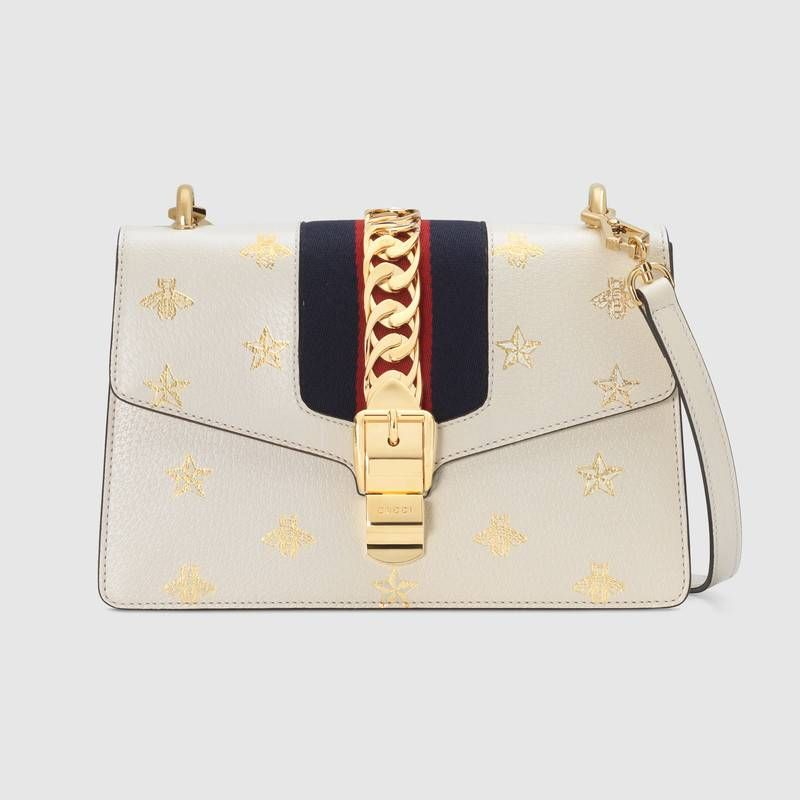 2d4f9025958bf8 Sylvie Bee Star small shoulder bag in White leather with gold bees and stars  print | Gucci Women's Shoulder Bags