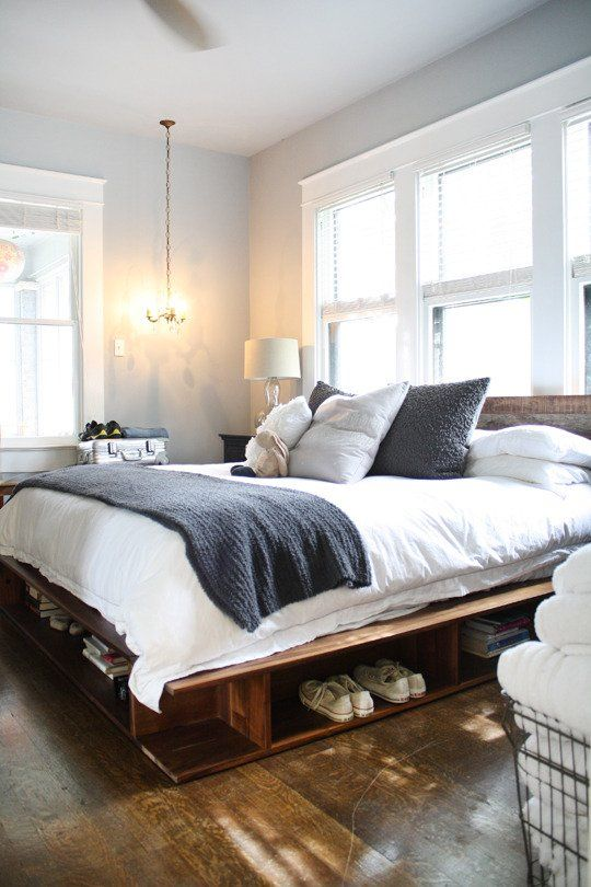 Pinned this because it gave me an idea! Turn tall skinny book shelves on their sides on either side of a platform bed. Doubles as storage and seating! :)