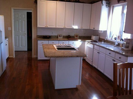 White Kitchen Cabinet With Brazilian Walnut Flooring Flooring Ideas Floor Design Trends Kitchen Cabinets Wood Floor Kitchen White Kitchen
