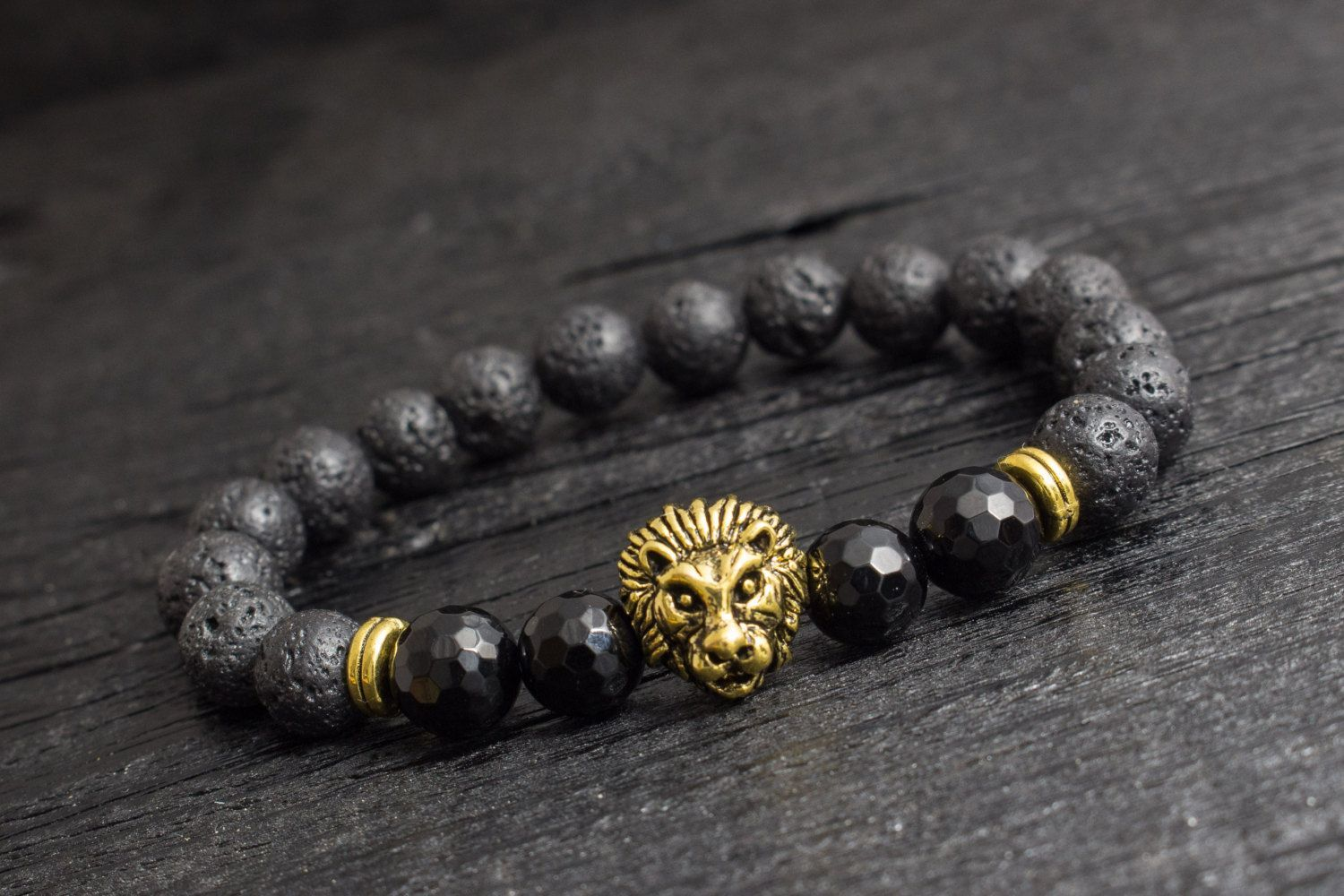 Black lava stone beaded gold lion stretchy bracelet with faceted
