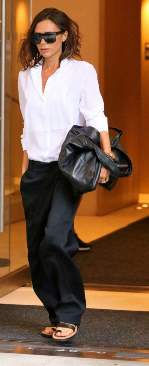 Who made Victoria Beckham's white shirt, black sunglasses, and flat sandals?