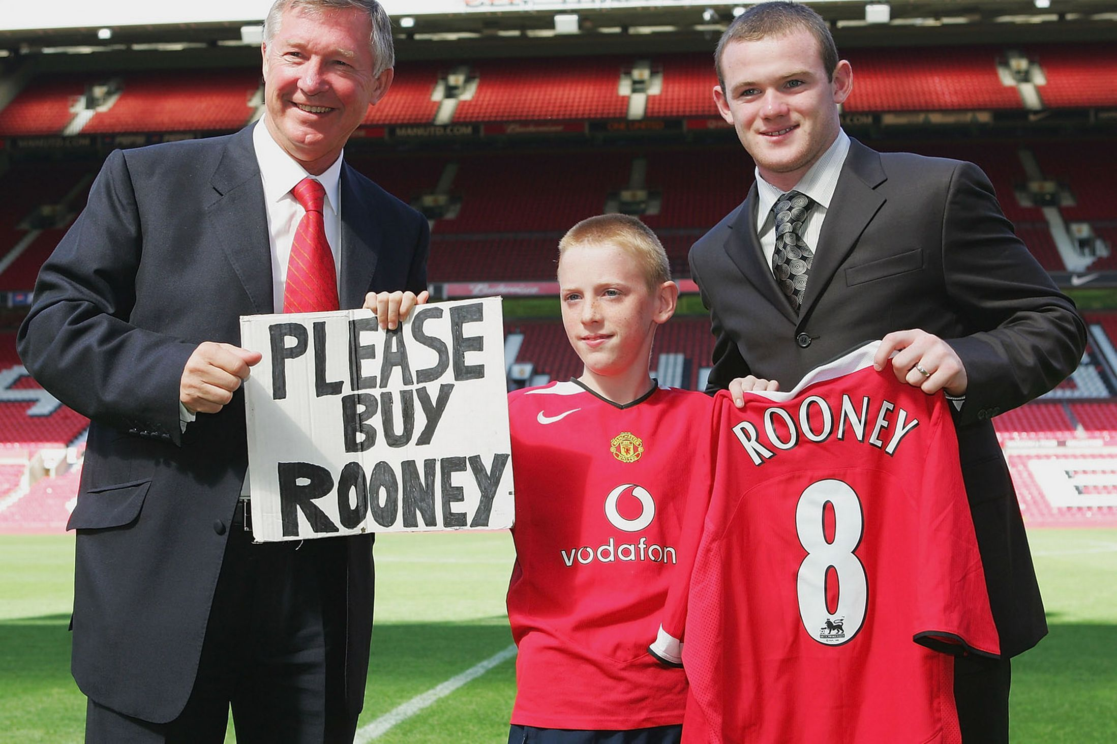 Sir alex ferguson poses with wayne rooney a united shirt and young united fan joe