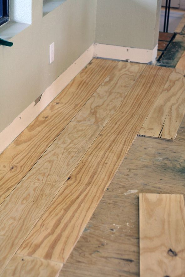 Little green notebook diy wide plank floors made from for Unusual inexpensive flooring ideas