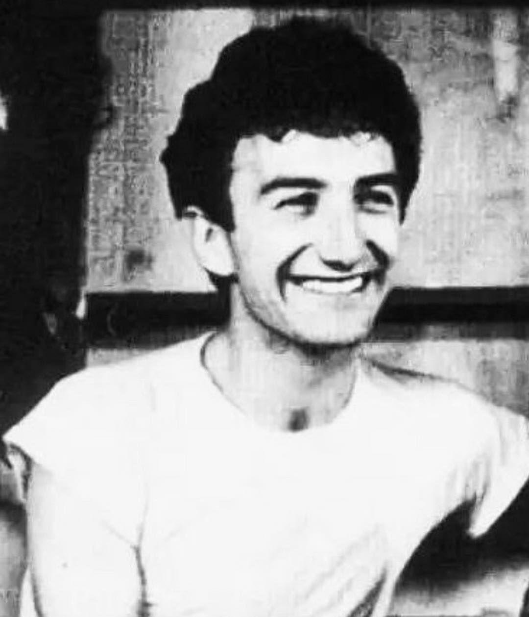 John Deacon smiles