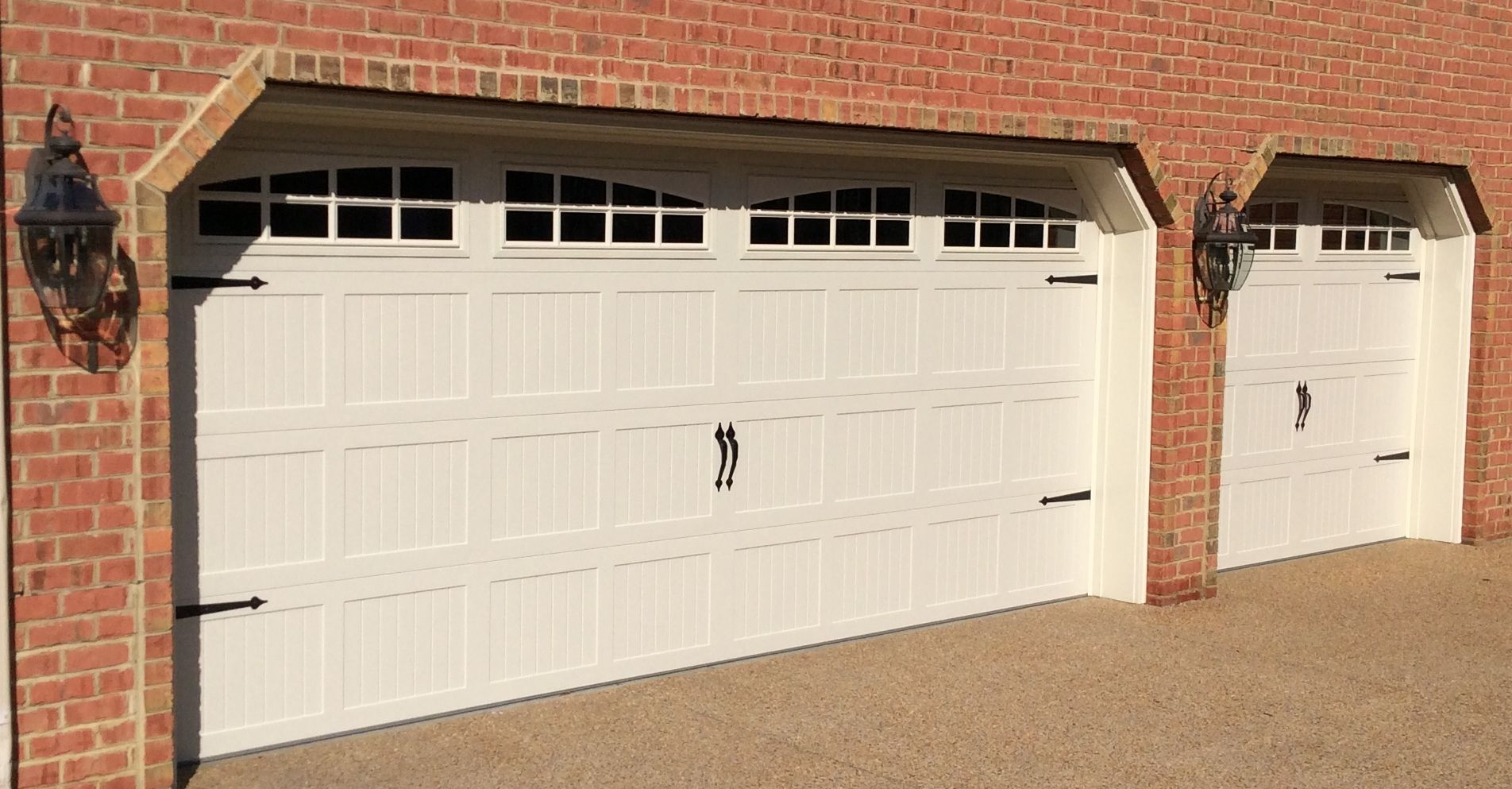 8x7 16x7 model 5216 almond carriage style steel garage doors with top stockton arched glass installed by the richmond store