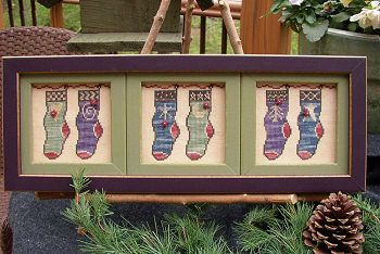 """Six Stockings in a Row"" by SamSarah Designs. I stitched it in one row, instead of in segments as pictured."