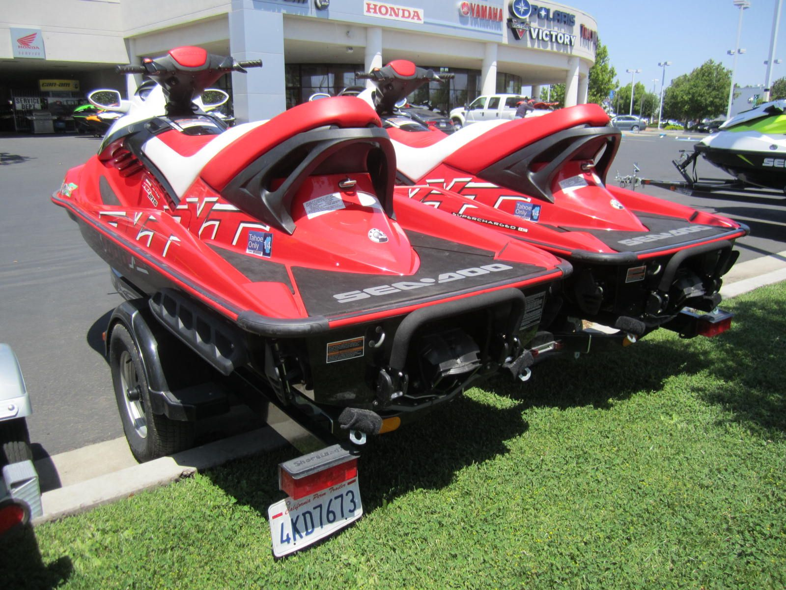Pair Of Red Seadoo Skis Mounted On A Double Trailer And Ready To Go Personal Watercraft Seadoo Water Crafts