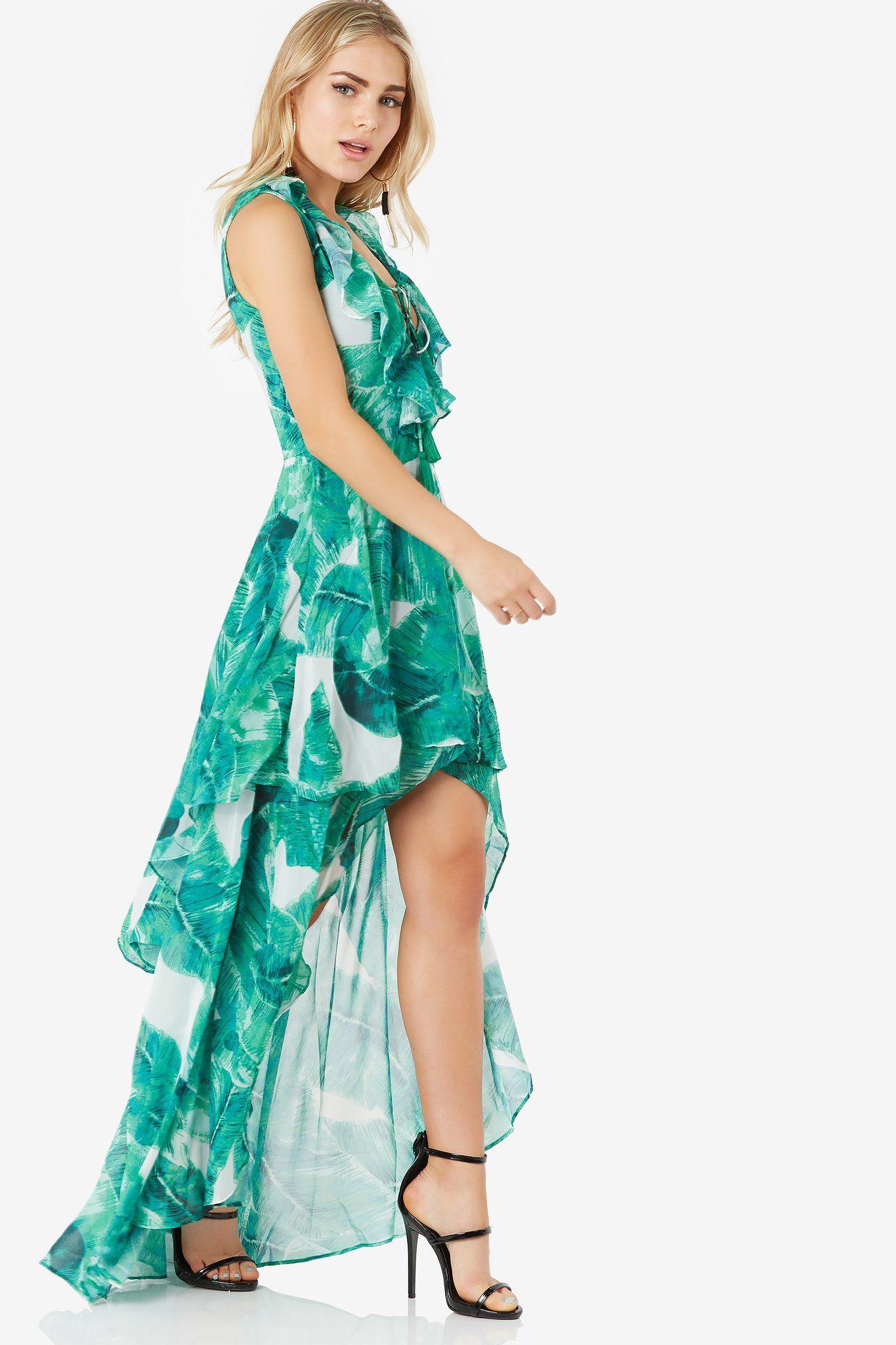Stunning hi-low maxi dress with bold print throughout. Ruffle ...