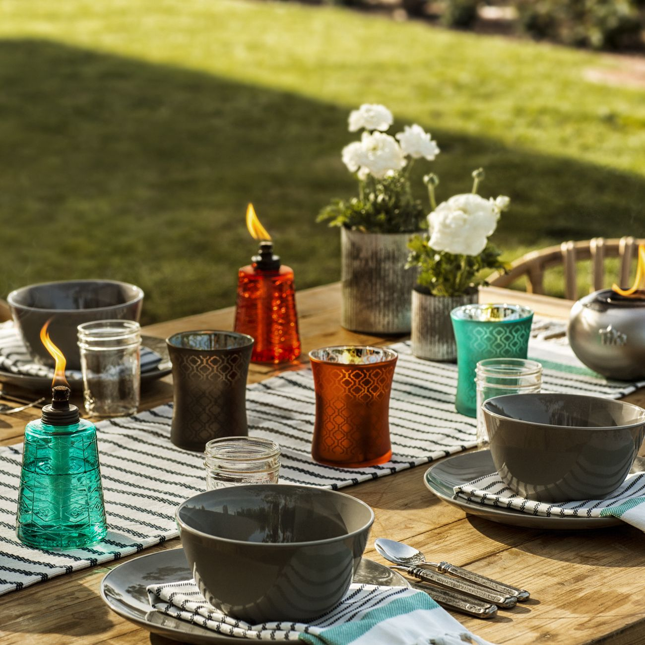 TIKI Brand Citronella Candles And Table Torches Come In Color Trios That  Provide A Contemporary Palate