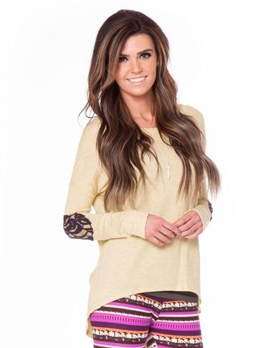 Get a head start on Spring fashion with this cute top! Pastel Yellow top  features black lace elbow patches 564434419