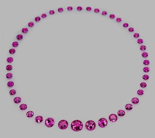 Extraordinary Gem-Quality Hot Pink Tourmaline Necklace Suite Nigeria Comprising forty-five circular-cut stones exhibiting the most vivid, unenhanced hot pink hue imaginable, the largest weighing approximately 6.59 carats graduating to the smallest which weights 0.68 carats. All cut from the same parcel of rough discovered in one find, this is an unsurpassed collection which would be difficult to replicate for color, clarity and overall quality. One can only imagine the stunning rivière…