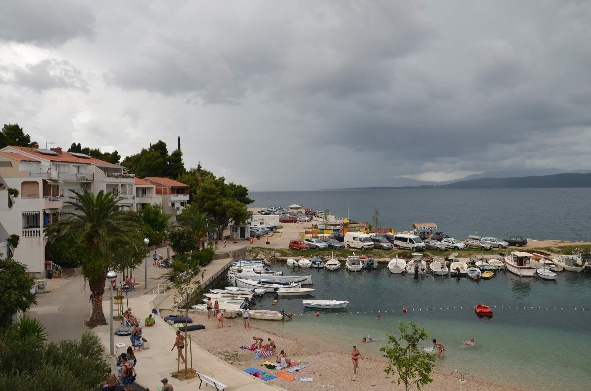 The weather can be changeable in Croatia as shown in this photo of the resort of Igrane. The storm clouds rolling in set against the harbour and beach make an interesting photo composition.