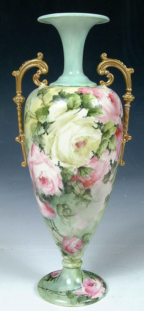 A CERAMIC ART CO. BELLEEK FLORAL VASE WITH TWO HANDLES, PEDESTAL BASE, ALLOVER ROSE PATTERN