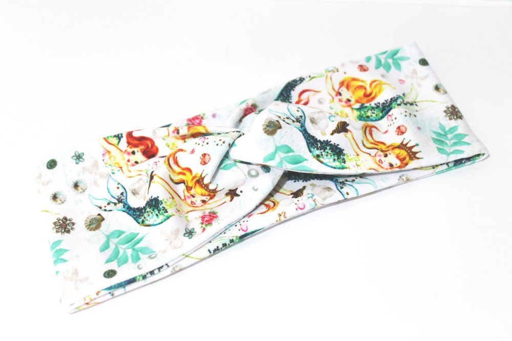 This funky headband has been created with our exclusive Vintage Mermaid fabric which is super soft and stretchy for optimum comfort and style.