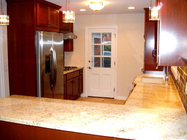 Shaker Heights OH Kitchen Remodel: Cherry cabinets, travertine tile, slate backsplash, crystal lighting, Stainless Steel Appliances, granite