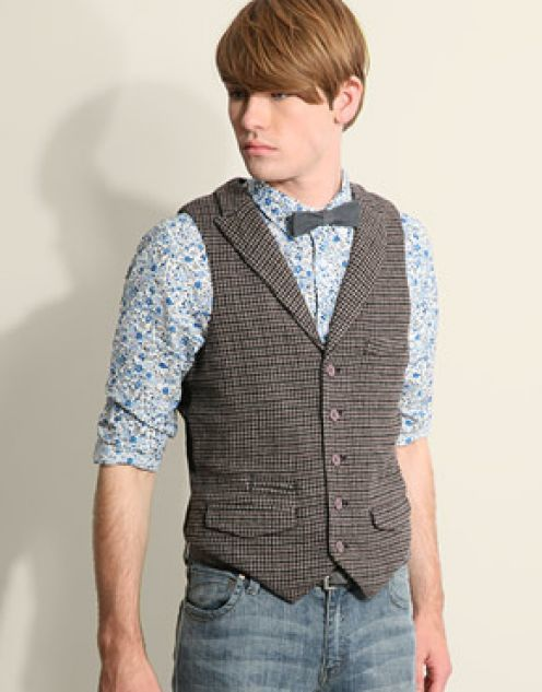 ok, look... The jeans & waistcoat are the win here.  This pattern against that plaid is making me nauseous and the bowtie is just wrong here.  So let's give him a C+ and move on...
