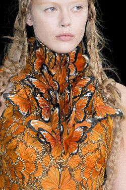 Alexander McQueen at Paris Fashion Week Spring 2011...worn by effie in the hunger games atching fire