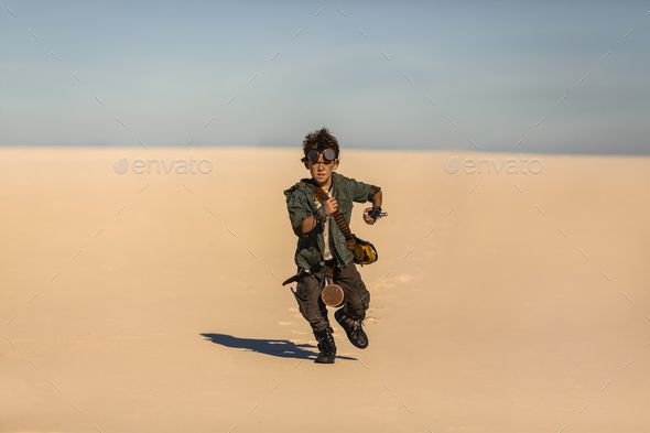 Post-apocalyptic Warrior Boy Outdoors in Desert Wasteland by artfotodima. Post-apocalyptic boy outdoors in the desert. People in nuclear post-apocalypse. Life after doomsday concept. Desert a... #AD #Wasteland, #Desert, #boy, #artfotodima