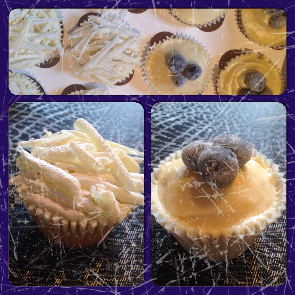 White choc cupcakes & lemon cupcakes with a mascarpone topping & frosted blueberries