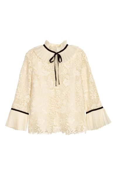 c60ddc97ab1bcc ERDEM x H&M. Lace blouse with pleated chiffon details, a pleated collar and  sewn-in tie in a contrasting colour. 3/4-length sleeves with decorative  grosgrai