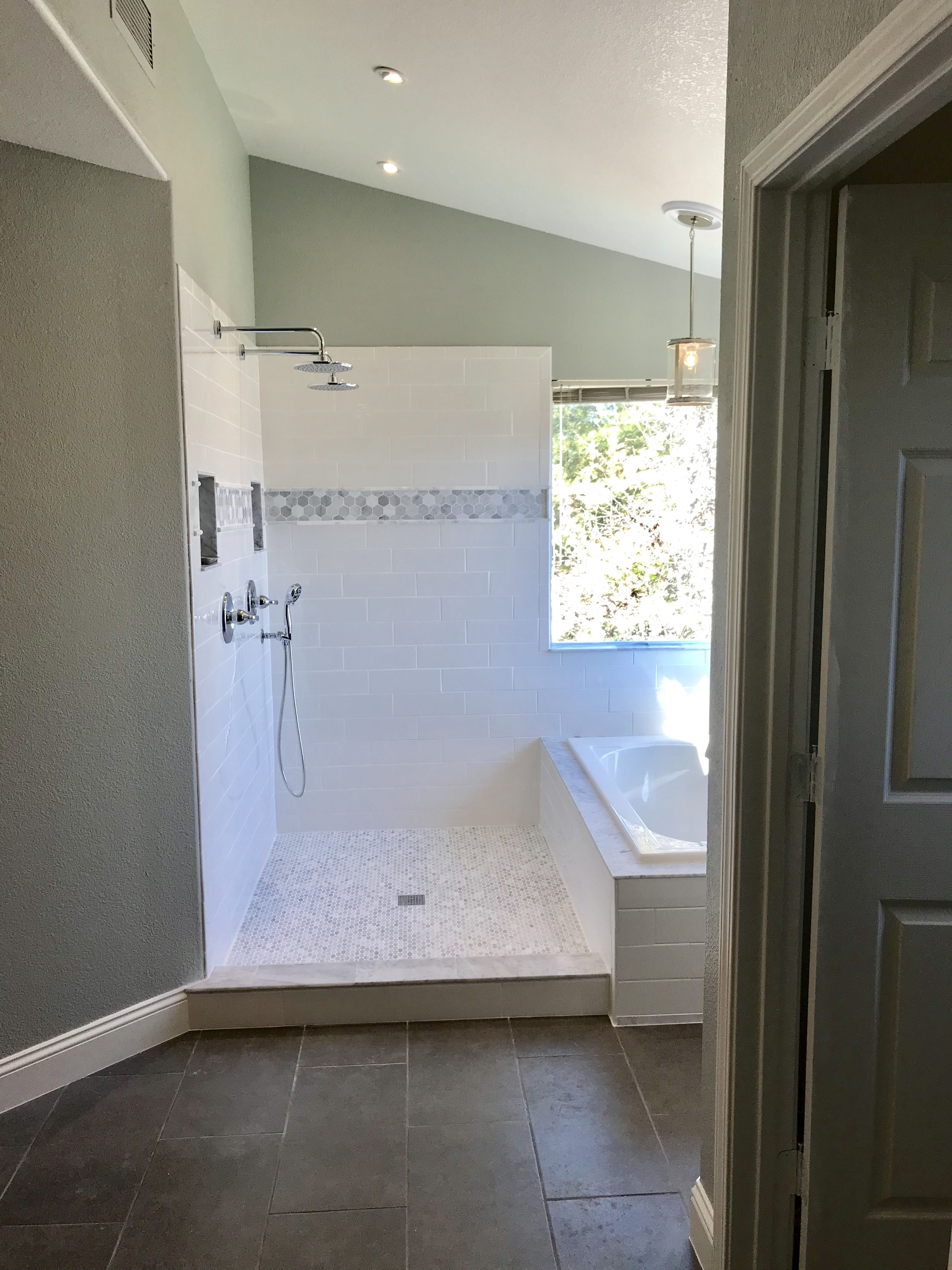 Love our new master bathroom! 4x12 subway tiles, marble accents ...