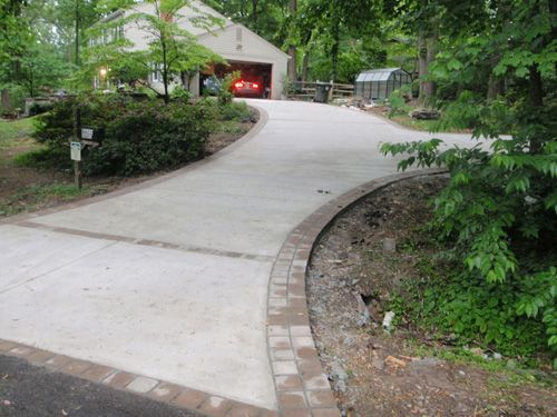 Concrete Driveway With Paver Border Driveway Walkway Walkway Landscaping Driveway Design Ranch Exterior
