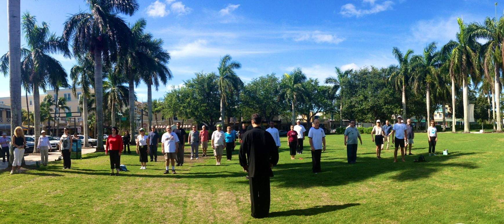 Laoshi nick leading a qigong class in the park on world