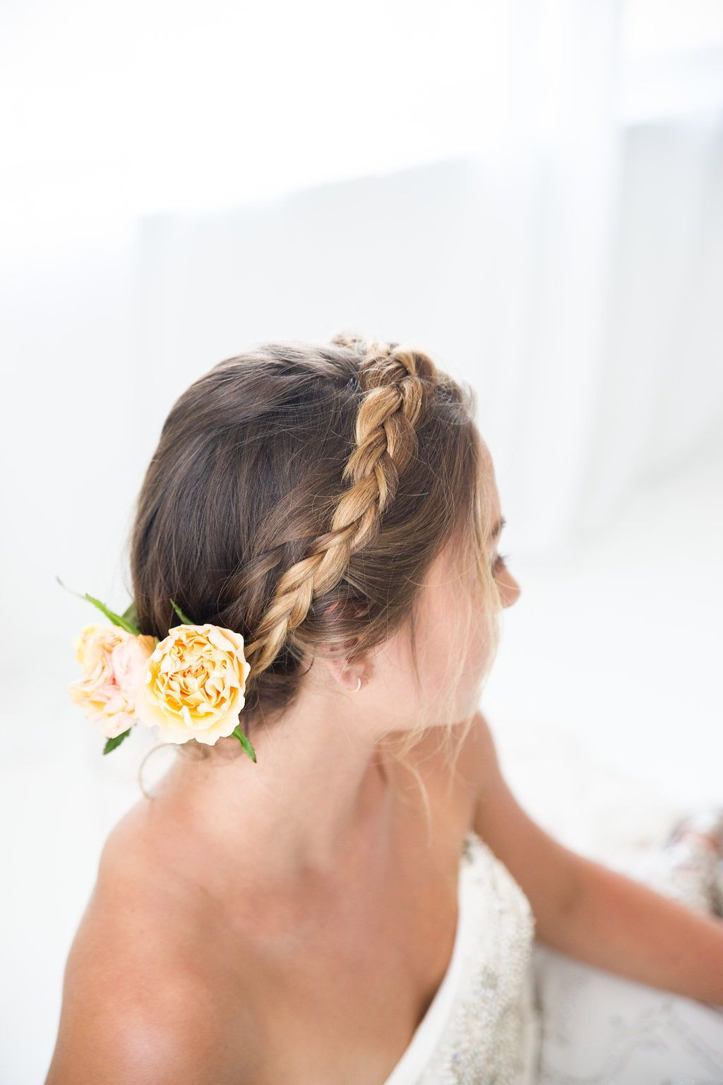 pretty bridal updo with braids and flowers. ideal for