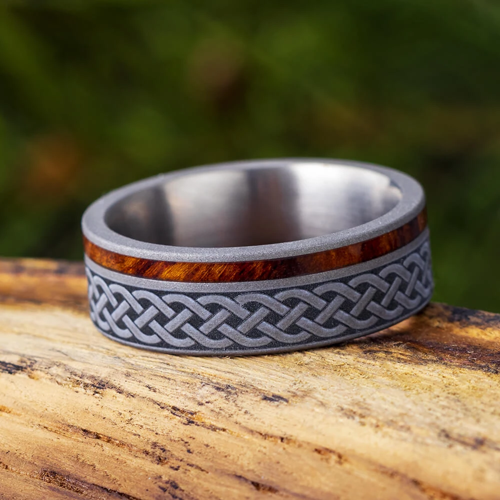It is a photo of Celtic Knot Ring, Mens Wood Wedding Band With Engraving, Titanium