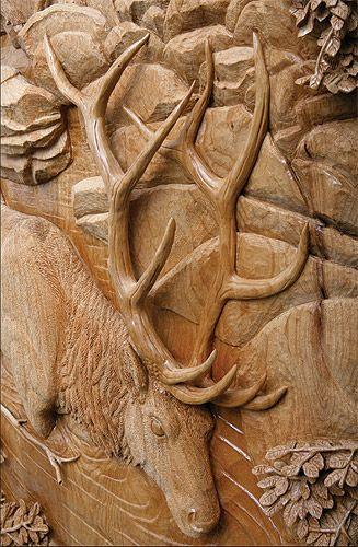 Elk carved door detail by ganley art wood carvings