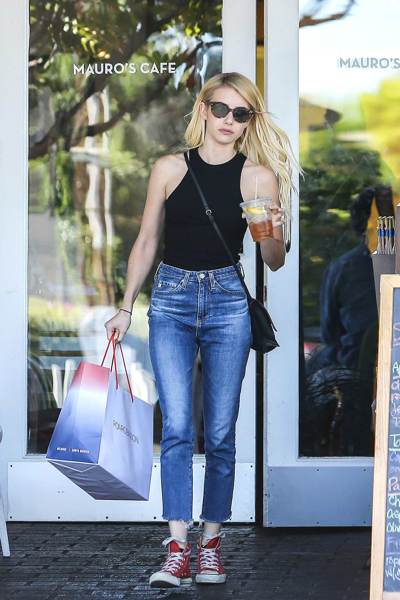 Actress Emma Roberts wore a pair of AG Phoebe Vintage Mom Jeans to do some  shopping in West Hollywood, California.