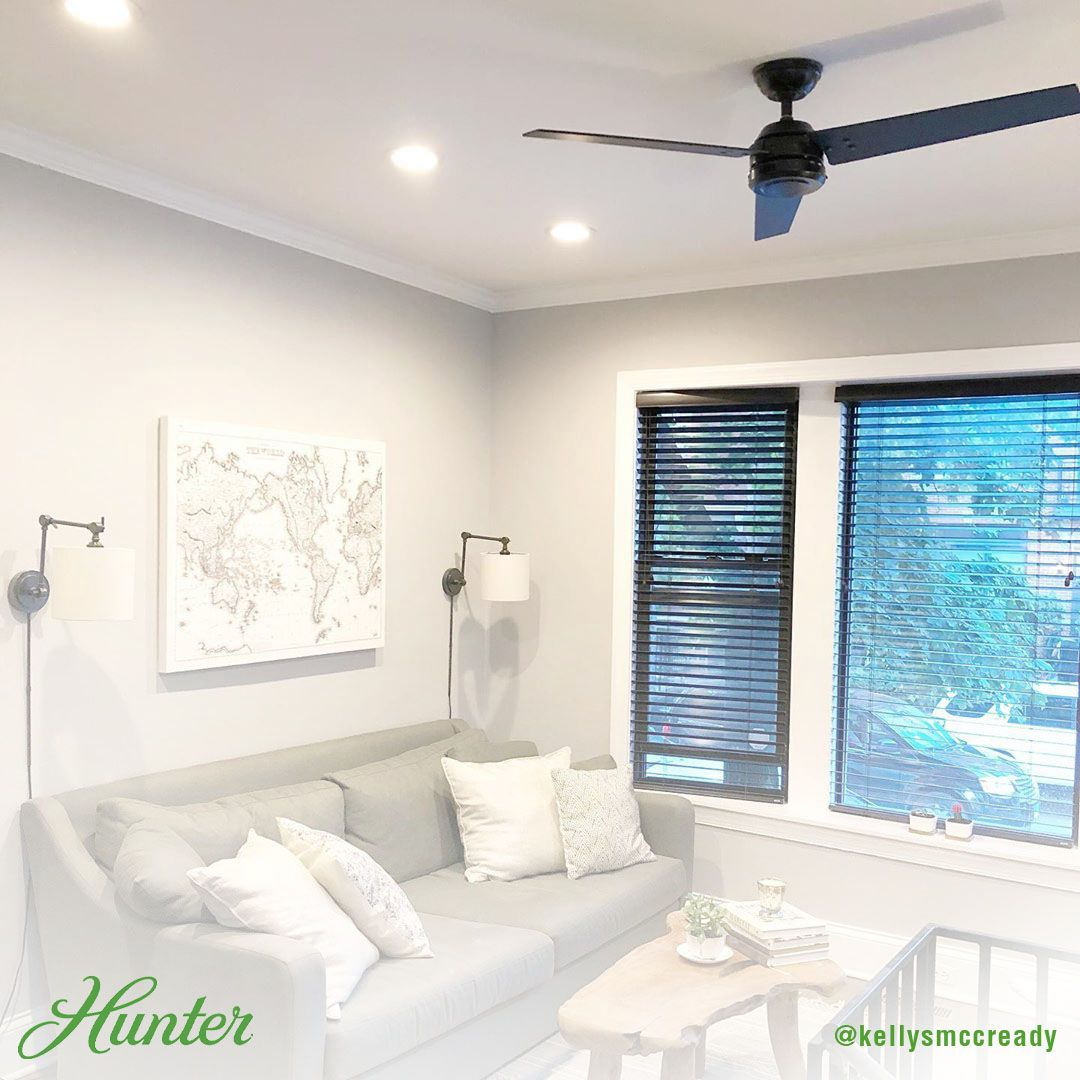 This Modern Living Room Was Completed With The Matte Black Cassius We Love The Bold Black And Living Room Ceiling Fan Black Walls Living Room Living Room Fans