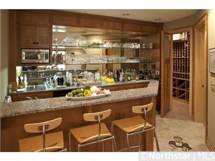 Bar area with attached wine cellar | 55 Clay Cliffe Drive, Tonka Bay, MN 55331