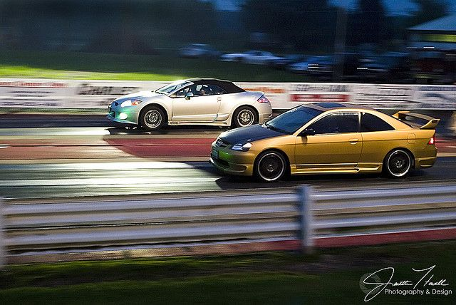 Mitsubishi Eclipse and Mazda??? If anyone knows what the gold car is, I sure would like to know!!     Nice mitsubishi photo found on the web