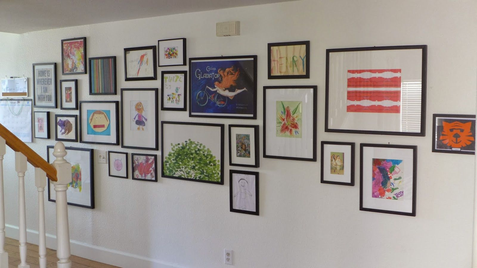anxiety rearranging: the gallery wall in the hallway- Gallery wall with a midline
