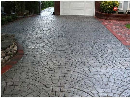 Charcoal silver concrete driveways starburst concrete for Concrete driveway designs
