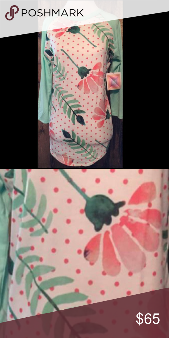 LuLaRoe Mint Color Sleeve/Floral Randy Brand new with tags attached. Hard to find print. Beautiful randy baseball tee in size XS. Perfect color combo for the upcoming spring season! LuLaRoe Tops Tees - Long Sleeve