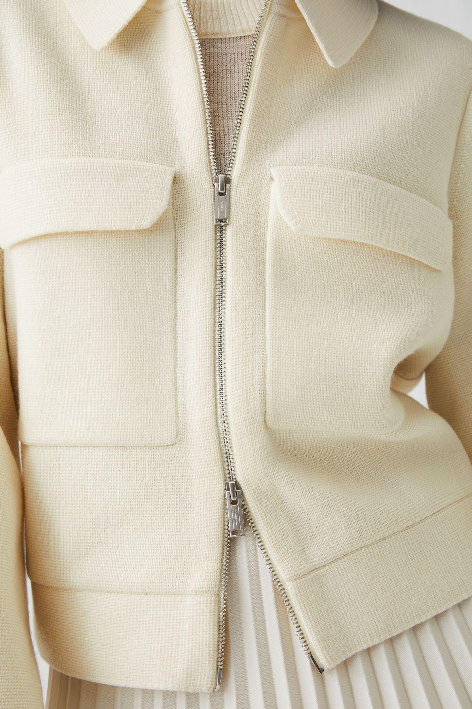 merino model of whiteher arket jacket in front sweaters