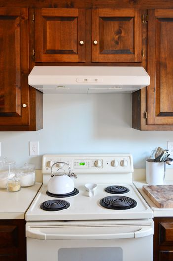 Replacing A Hanging Microwave With A Range Hood Young House Love Hanging Microwave Lake House Kitchen Kitchen Remodel