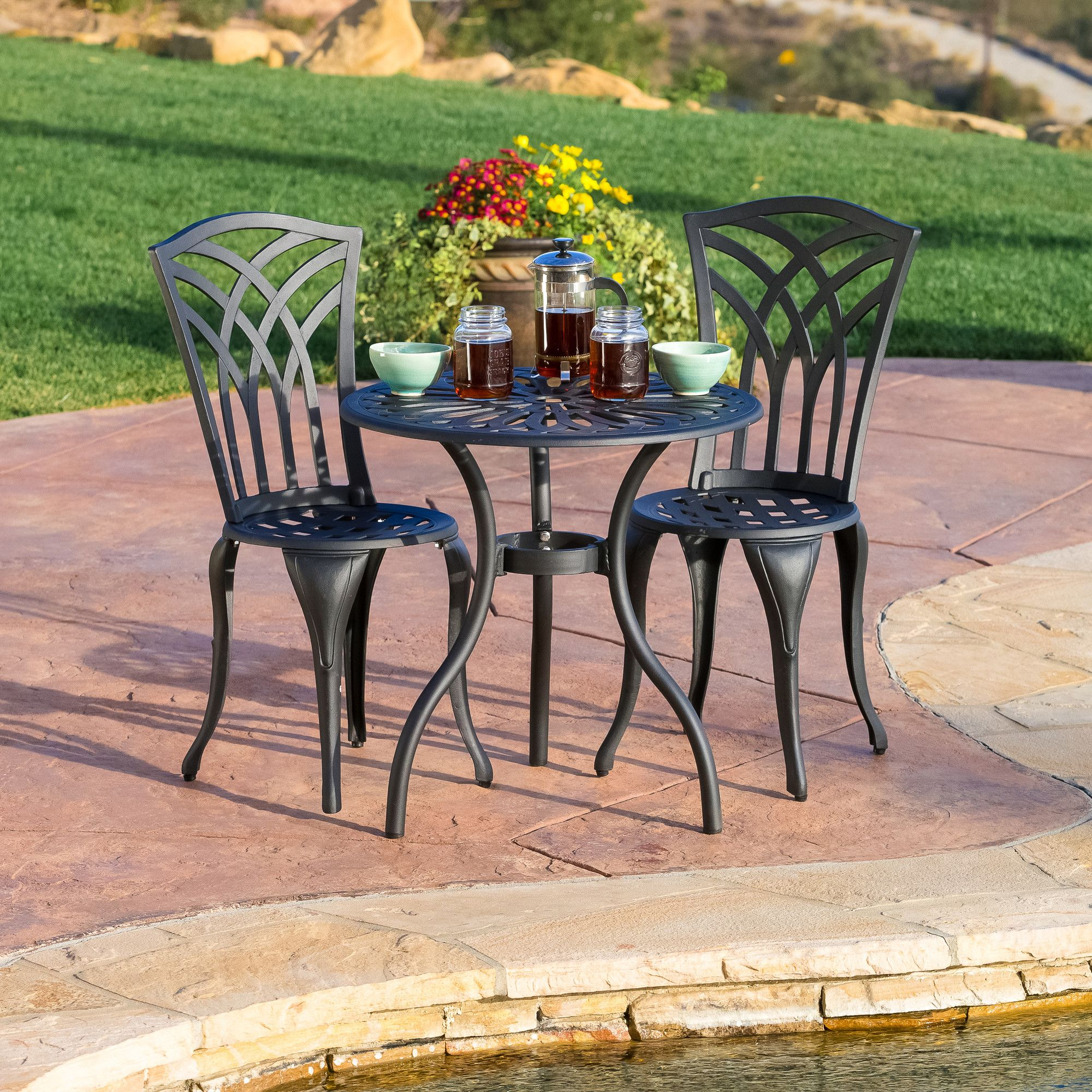Features:  -Set includes 2 armless chairs and 1 round mesh table.  -Material: Cast aluminum.  -Intricate detail on backrest and table-top.  Product Type: -Bistro set.  Inner Frame Material: -Aluminum.