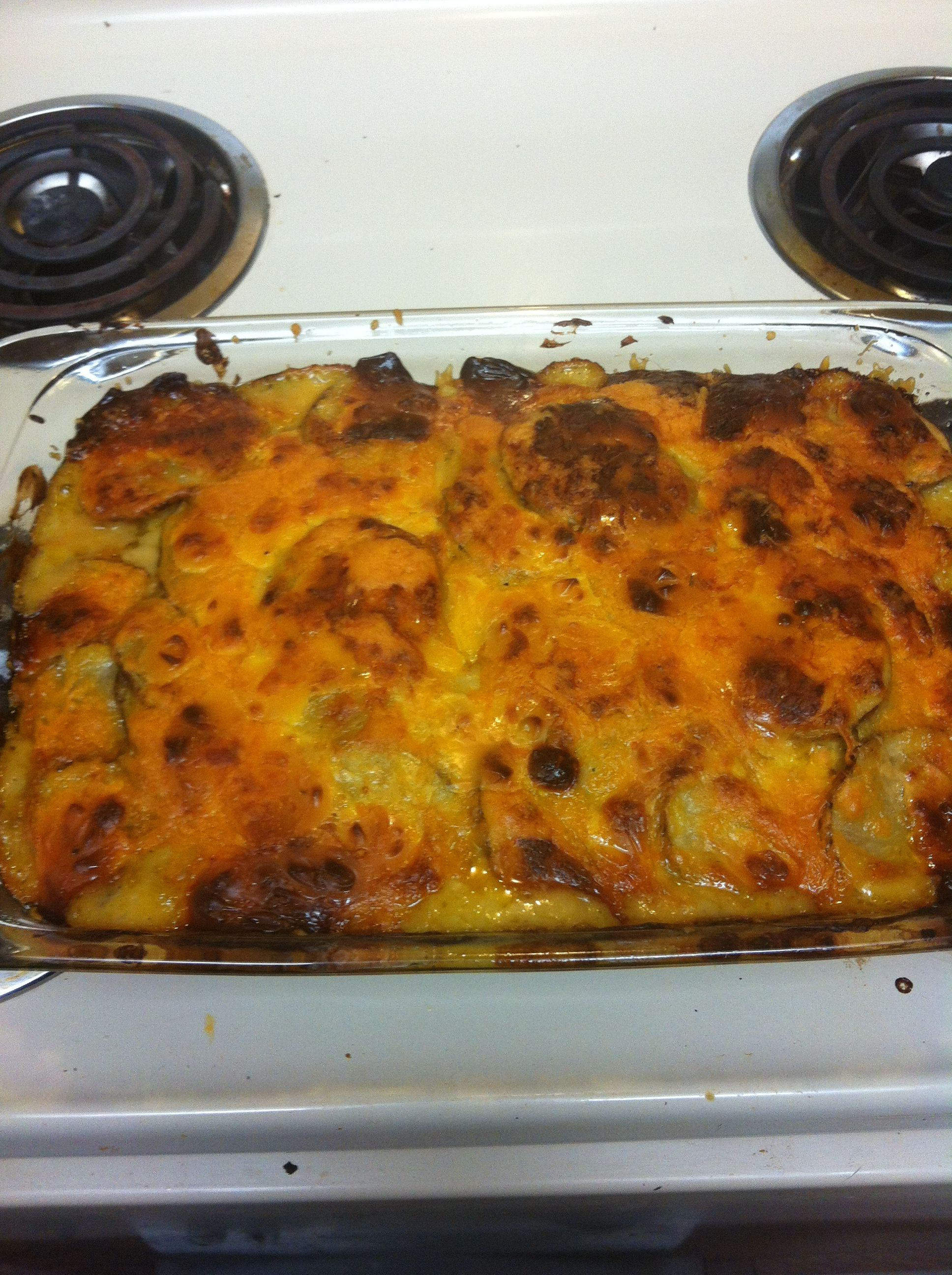 Homemade Augratin potatoes. Very easy. Potatoes, sliced thin. Cheddar cheese, packet of hollandaise sauce, can of cream of broccoli soup, layered and baked. Really yummy!!